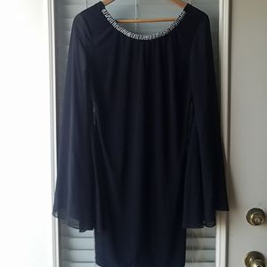 Black Dress With Sheer Sleeves and Beaded Neckline